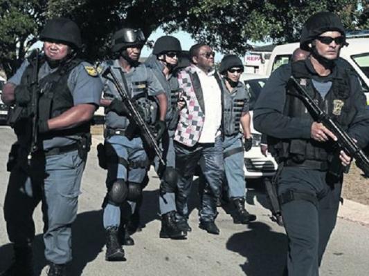 Tim-Omotosho-in-police-net