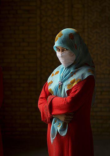 Muslim Uyghur woman in Keriya mosque Xinjiang China